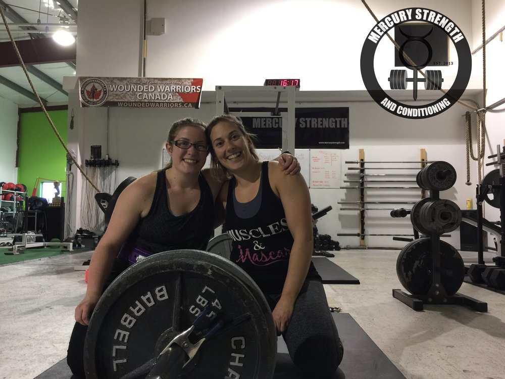 Hannah and Jess posing with their 315 deadlift