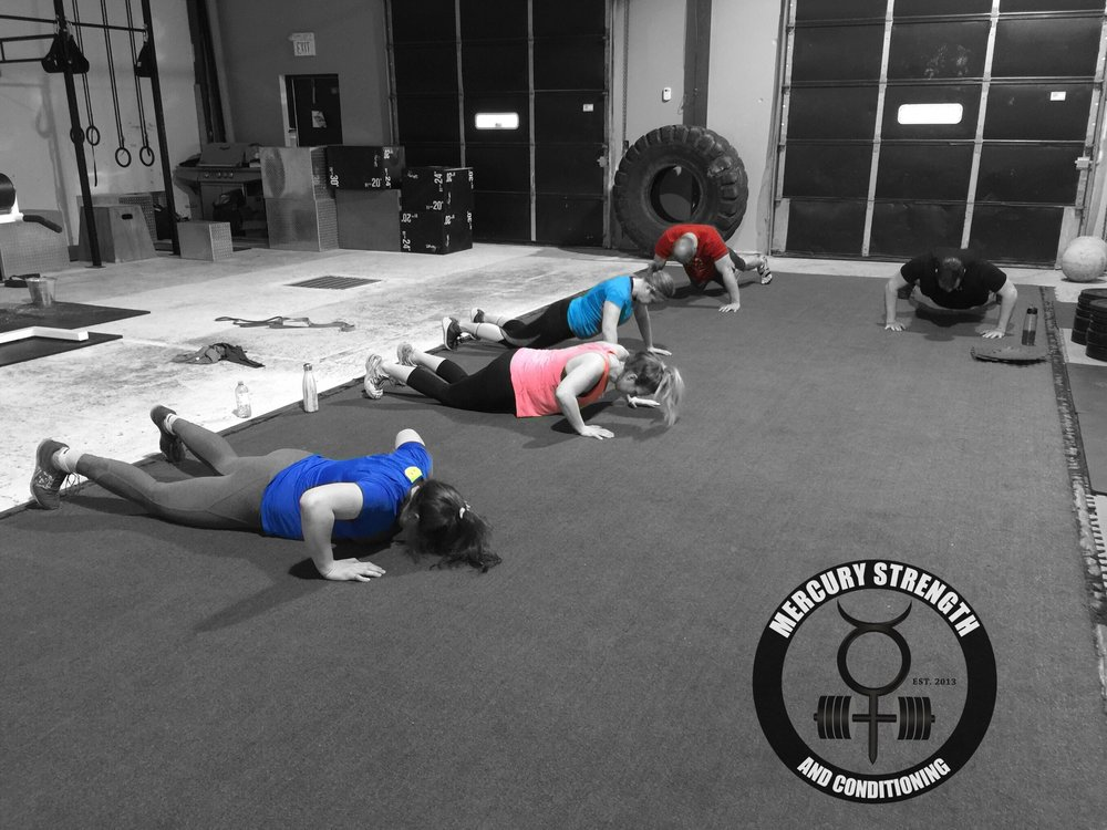 Morgan, Amber, Tara, Keith, and Steve with 1 of their 100 push-ups from yesterday