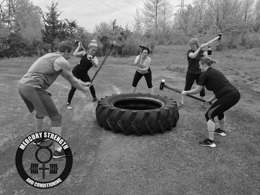 Lucas, Kelsi, Lindsey, Shelley, and Tara with some tire hits during a grueling conditioning workout yesterday