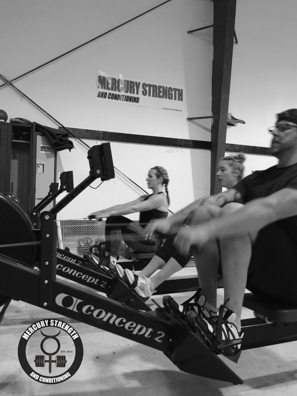 Kelly, Julianne, and Corey pushing hard during a 250m row