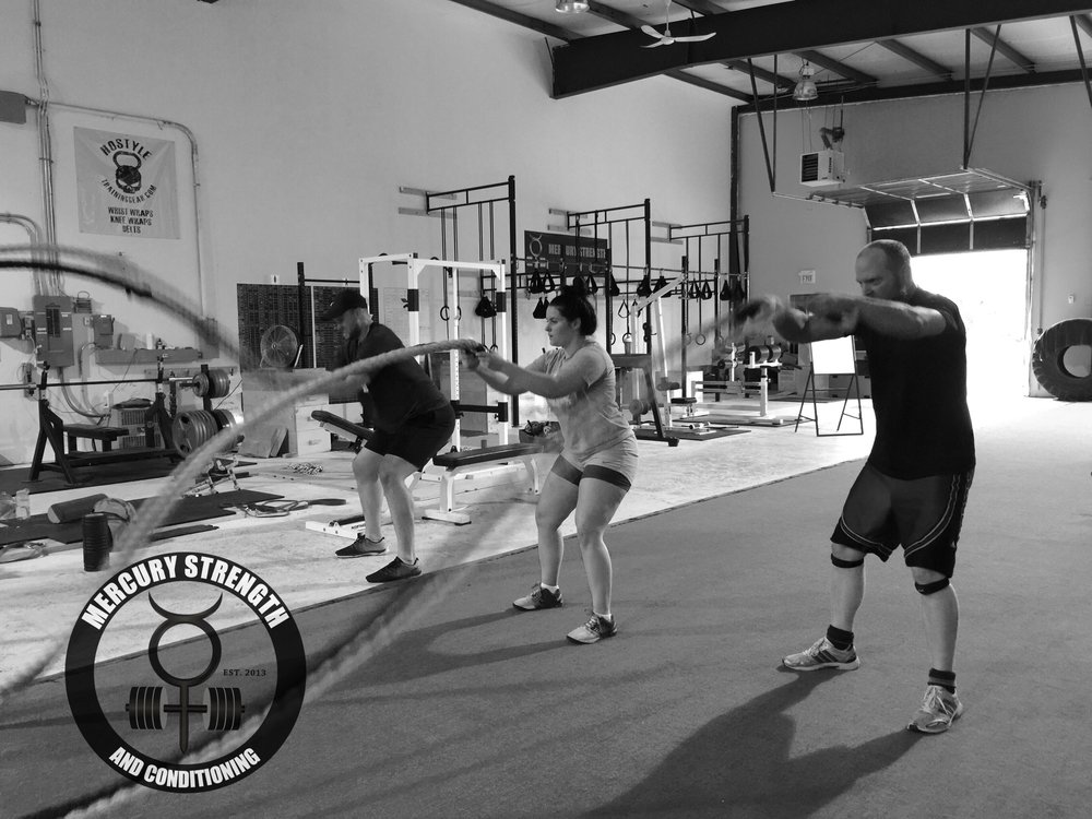 Clint, Kailey, and Rob with some battle ropes