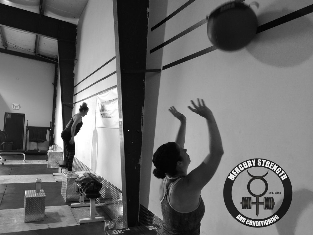 Jen and Julianne with some wall balls and box jumps during yesterday's really tough conditioning