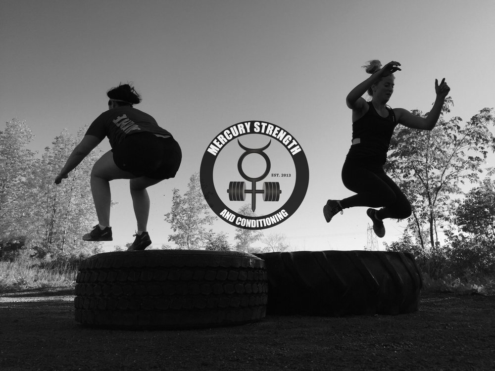 A photo from late spring of Kailey and Kelsi doing tire jump throughs