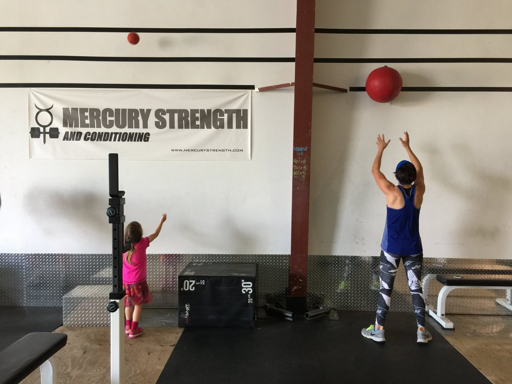 Michelle and her daughter with some wall balls