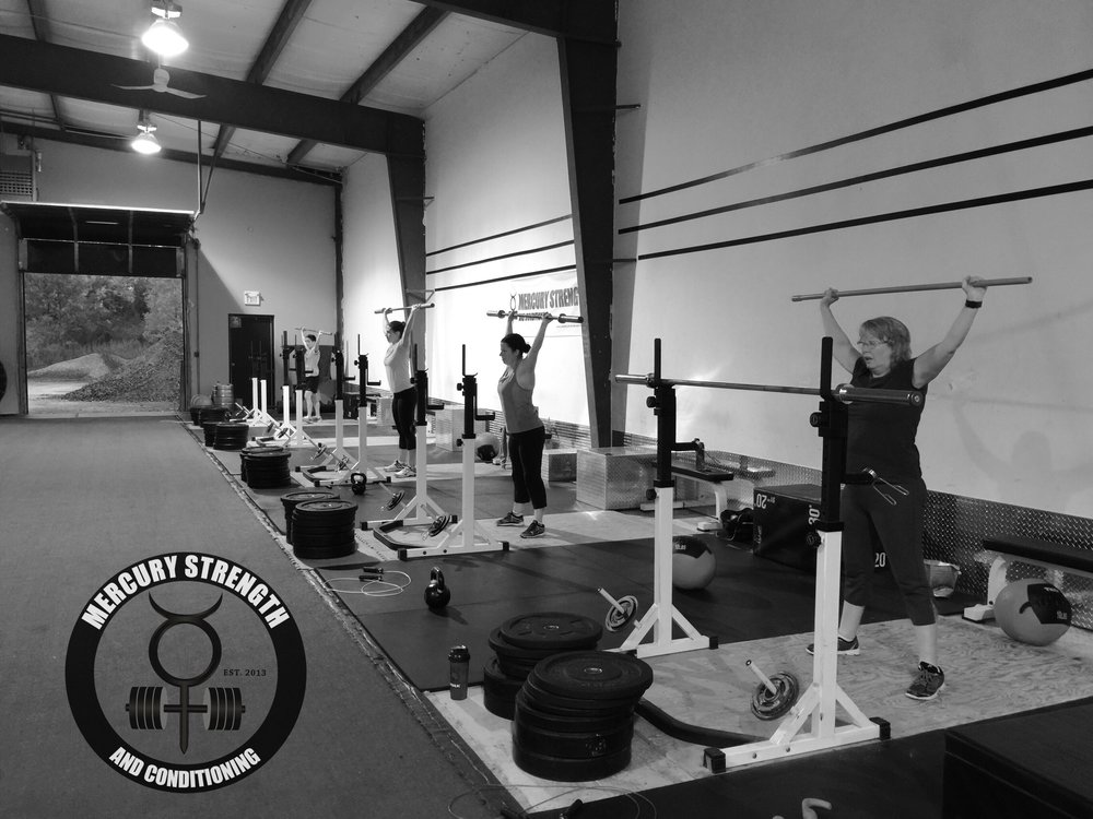 Shelley, Jen, Mila, and Michelle with some overhead squats during a tough conditioning workout yesterday