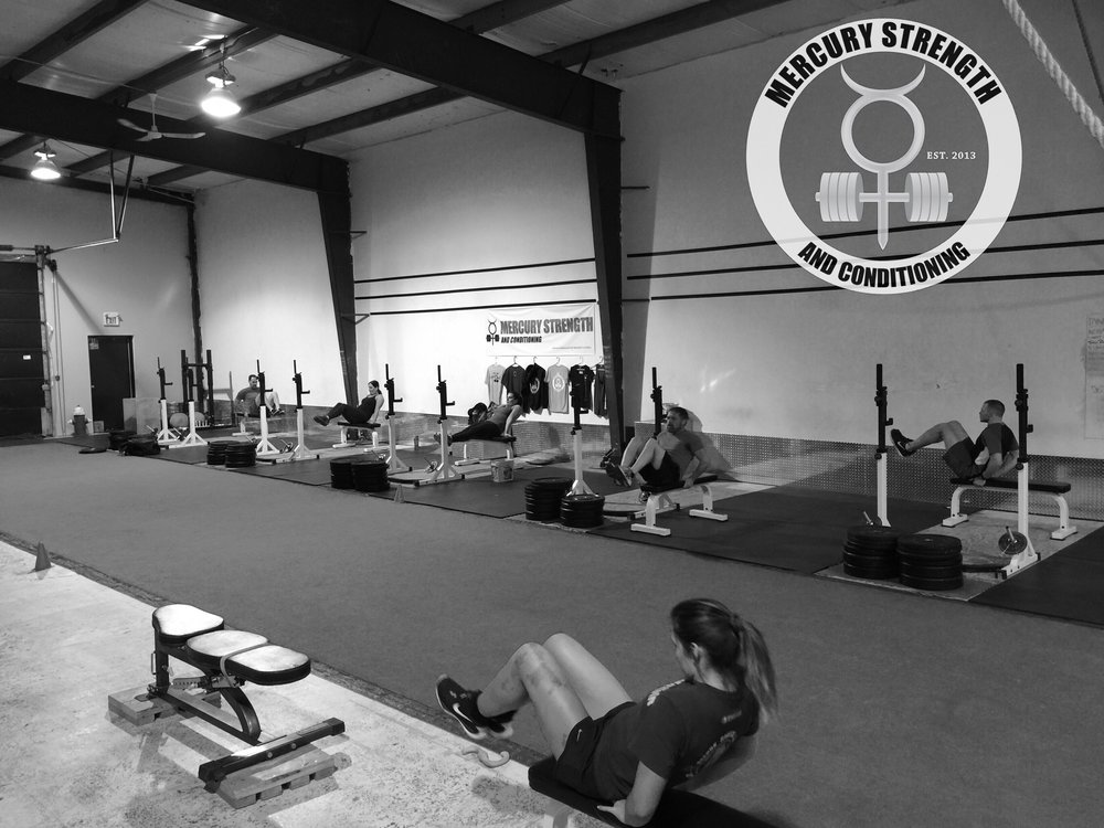 The 12:30 crew with some Tabata v-crunches