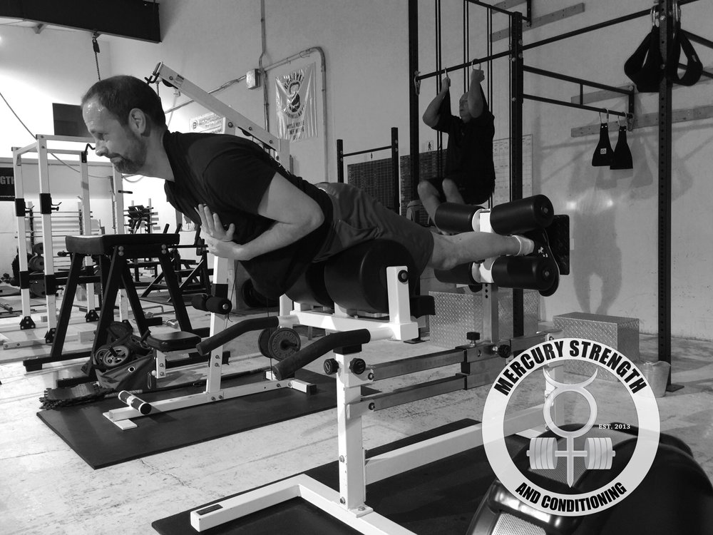 Andrew getting some back extensions in while Curtis is cranking out some knees to elbows