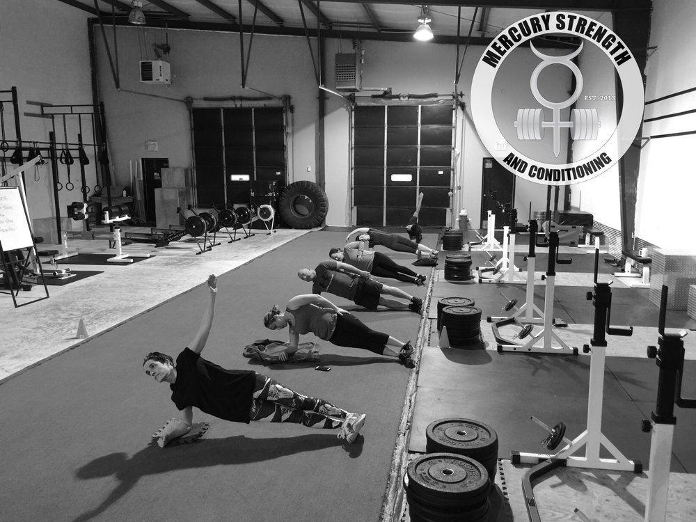 A bright-eyed 06:30 crew going through some Tabata abs