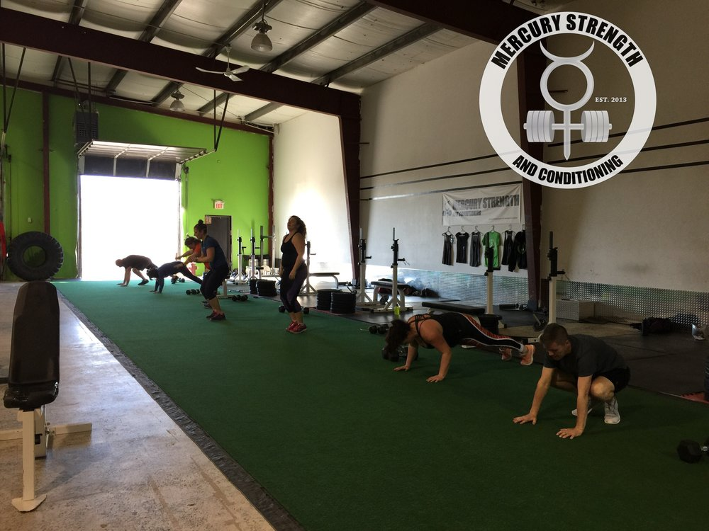 Some of the 5pm crew starting the conditioning workout with some burpees