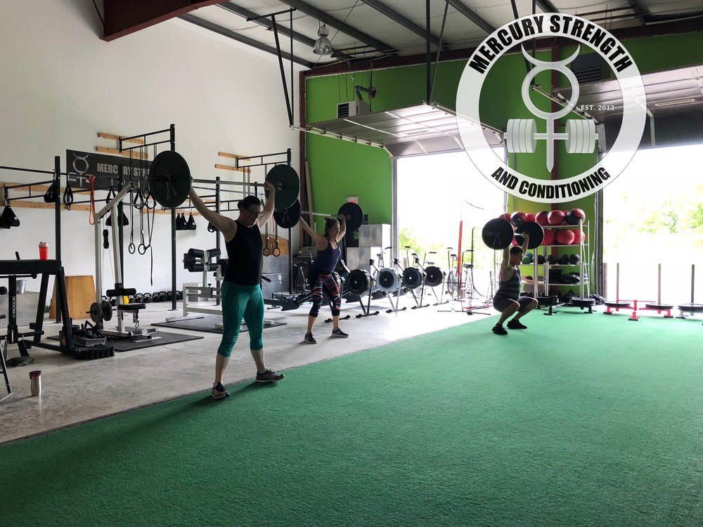 Katherine, Julianne, and Eddy with some overhead squats