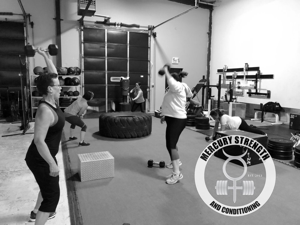 Gym-powerlifting-Olympic lifting-fitness-personal training-training-bootcamp-crossfit-kingston-kingston gym-kids-mercury-strength-conditioning-athlete-Tire Hit-dumbbell-Hang Power Snatch