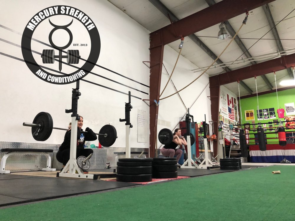 Tara and Katherine with some great form on front squats