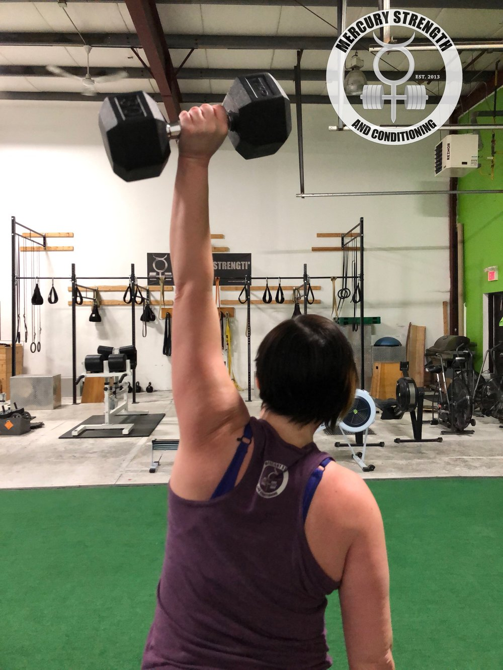 Lindsey at the tail end of a burpee to DB power sntach