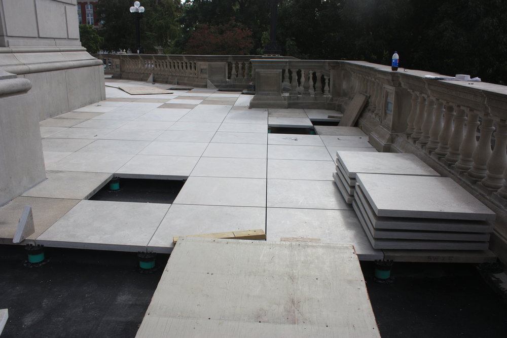 The pedestal system allows the stone pavers to shift and expand naturally with a lesser risk of cracking. It also allows rainwater and snowmelt to pass through to the empty space beneath the pavers and drain away. This means no water becomes trapped between or beneath the stones, which will help ensure the longevity and quality of the stone.