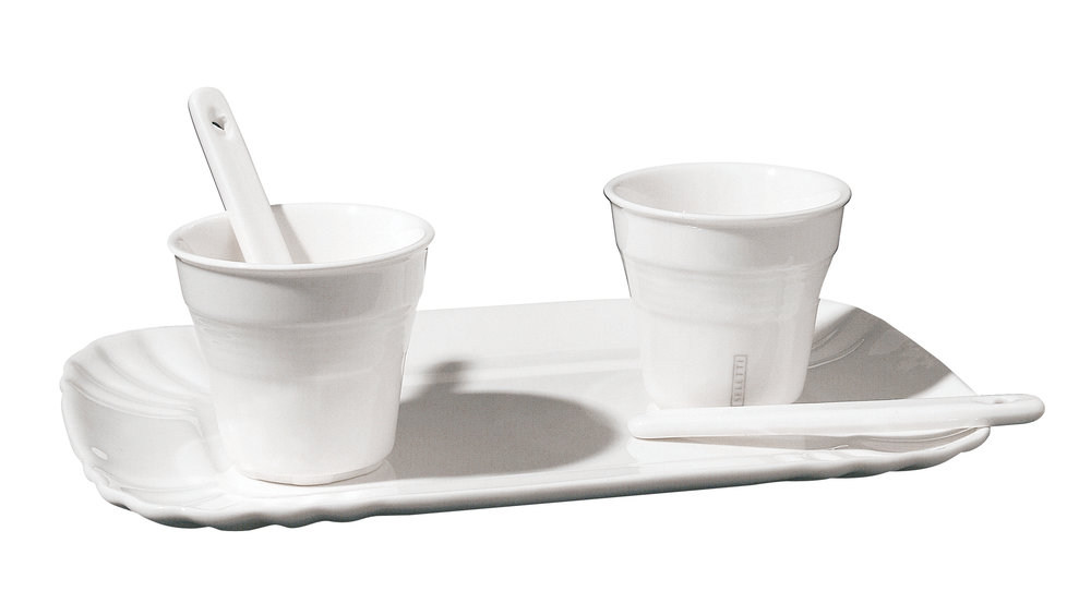 The perfect twinset of espresso cups and stirrers on their own little tray, from the Estetico Quotidiano range by Seletti