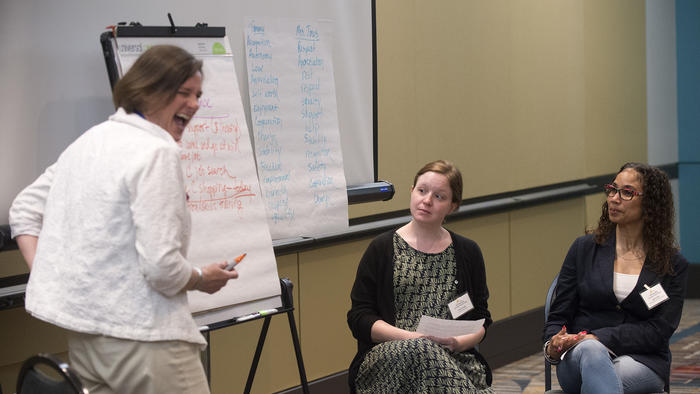 "Connecticut was one of the 10 communities chosen by HUD to build processes in our communities with the intention of using their models to end youth homelessness.  In their application, they said they ""..will develop a community plan that...will focus on: improving prevention and identification of youth experiencing homelessness; strengthening the coordinated entry and crisis response system to effectively serve youth; and identifying appropriate and cost effective housing and service interventions that provide long-term positive impacts.""  Angel Cotto and Natalie Garcia combated homelessness in their youth. They spent Thursday giving service providers a firsthand account of how the system works -- and how it doesn't.  The two were featured presenters during the Connecticut Coalition to End Homelessness's annual training institute, a gathering of about 400 organizations working to fight the issue, including shelters, housing providers and philanthropies.  Thursday's gathering came after a year of sweeping progress for the coalition, which saw a 24 percent decrease in the number of homeless individuals in the state from 2007 to 2017.  It's a subject both Cotto and Garica are intimately familiar with: As researchers with the Institute for Community Research's Youth Action Hub, they've been gathering data on homeless youth from across the state.  ""It's a matter of getting youth to not only having voice in how services are offered, but also partaking in the decision-making process,"" Cotto, an 18-year-old Hartford native, said. ""Instead of not knowing about policy until after the decision was made, and providers not asking for their opinion until after the decision, we want them to be involved in making the decision in the first place.""  The two dove into the research field to leverage their backgrounds into improving life for youth in situations similar to the ones they faced.  ""There are some young people who have had negative experiences with the system in the past and are reluctant to turn to anyone for help,"" said Garcia. ""If you're a provider, you may be looking at this from a different perspective than us, who actually have knowledge of how the system works in practice.""  ""So we use that perspective to try and re-open that door to aid that homeless youth have closed because of their negative experiences,"" she added.  That philosophy aligns well with the general objective of the annual training institute, according to Lisa Tepper Bates, the executive director of coalition.  ""You have to invest in training people, and you have to give them an opportunity to sit back and reflect on what they're doing and how they can improve on it,"" Tepper Bates said. ""So we're bringing together the best ideas and giving people who are working in the trenches every day with the folks on the streets the opportunity to see how they can work differently and more effectively.""  The training centered on workshops and presentations from professionals in a variety of fields, including education, housing and corrections. It was immersive learning, including a meticulous role-playing session that simulated mediating a dispute between a homeless teen and his parents.  Sometimes, in instances such as that simulated dispute, proper techniques can prevent homelessness and save resources in the long run, Tepper Bates said.  ""When we work effectively to prevent their homelessness or work to bring them out of their homelessness to housing, we are making communities better places and we are saving wasted expenses."""
