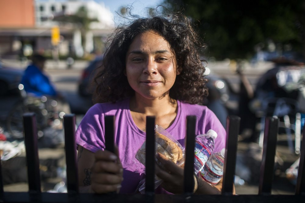 "Maggie Reyes was hanging out with a group of homeless people at a makeshift encampment in front of Tommy's Burgers on Hollywood Boulevard. The spot, near the 101 off-ramp, is a good place to panhandle.  http://curious.kcrw.com/2017/07/why-are-there-6000-homeless-youth-in-la  ""Some of us are out here because we don't have a choice,"" said Reyes. ""Our parents treated us really bad and we ended up in foster care and foster parents aren't that nice either. So you know, a lot of us ran away.""  Reyes, who is 24, is one of the n early 6000 homeless youth in Los Angeles County, a number that's 61 percent higher than last year.   Maggie Reyes, 24, has been homeless, on and off, since she was 18. She said many homeless youth, like her, were in and out of the foster care system, because their parents didn't treat them well. Reyes said, ""My mom, before she passed, told me 'Don't end up like me. Get sober. You need to get yourself off the streets.' and I've been working on that."" (Photo: Dania Maxwell)  I n part, the spike in youth homelessness can be attributed to better counting.  However, a bigger reason is that young people simply can't afford to live in LA, according to Bill Bedrossian of Covenant House California, a youth homeless services agency.  ""Where they used to be able to live on the margins and bunk up with friends and split the rent, now it's just so high, that, even in that case, if they're not making significantly more than minimum wage, they're not able to live,"" said Bedrossian.  Service providers in Los Angeles say that, more and more, homeless youth are coming from impoverished families who don't have the resources to help, even if they want to.  This was the case for Leo Serrano, an 18-year-old community college student, who found help at Jovenes Inc., an organization in Boyle Heights that serves homeless youth. Serrano, whose parents live in Mexico, was staying at his grandmother's house, but when she faced eviction for having too many people under one roof, he was forced out.  Before finding Jovenes, Serrano said he was staying at a temporary shelter, while going to school and holding down a part time job. "" [It was] really, really hard, because when you left the shelter, you had to bring all your stuff with you. So, you can just imagine going from South LA all the way to downtown LA with all my stuff in a duffel bag and a backpack and a bike.""  Eric Hubbard, development director at Jovenes, said the answer is in affordable housing. With that goal in mind, Jovenes recently bought several houses in East LA, so the organization can rent out rooms for $500 dollars a month to youth in need. Fifty dollars of the rent received will go into a savings account for that young person.  Hubbard said despite the challenges, it's important to reach the younger population, because they can be set on a course out of homelessness and still can aspire towards big goals.  ""They come from so many different backgrounds and so many experiences, but we have a common goal for them, and that's to increase their own self sufficiency, their independence, move into their own apartment, get jobs and live a normal life,"" said Hubbard."