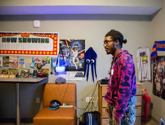 "Anthony Anderson, 22, was homeless for three years and eight months. Now he is  one of 38 young adults who have moved into apartments at the 66 West complex in Edina.    http://www.startribune.com/once-homeless-young-adults-settle-in-at-new-apartment-complex-in-edina/439109263/   Dozens of posters, toys and trinkets adorn Anthony Anderson's new studio apartment in Edina.  Several of the items were given to him during his stay at a Minneapolis shelter. Anderson, now 22, kept track of how long he was homeless: three years and eight months.  ""Most of this is just donated stuff given to me,"" he said. ""Whatever a person gives me, I don't complain, I just take it.""  One item does hold special meaning — a necklace with a small cross, hanging from the wall behind his bed.  ""That's the last thing I have from my grandmother,"" he said. ""I always have it hanging above me, just to help me sleep.""  Anderson is one of 38 young adults living at 66 West Apartments, a housing complex for young people who have been homeless. Beacon Interfaith Housing Collaborative, the developer, held a grand opening last week for the $11.4 million complex.  Danae Gilbert spoke to patrons during the grand opening celebration for the 66 West Apartments in Edina. ""I didn't have to worry about things anymore as far as being stable,"" she said.  It's the third project of its kind that Beacon has developed and is its first in the suburbs. The nonprofit group opened a similar complex with 44 units in St. Paul last fall.  The young tenants, most of them between ages 18 and 21, have personal yet all-too-similar stories.  They come from dysfunctional families and have  slept in shelters and foster homes and on couches; sometimes they had no place to spend the night at all.  There are anywhere from 250 to 300 young people like them in the Twin Cities' west-metro suburbs, according to Beacon.  But 66 West, located near Xerxes Avenue S. and W. 66th Street, is more than just beds.  Residents have four full-time employees  who guide them through school, work, community relationships and other life skills.  The goal is for tenants to become stable enough to move within a couple of years to different housing,  this time on their own terms.   ""It really opens up that hope, moving out of survival mode,"" said Lee Blons, executive director for Beacon. ""This is that chance to get that support.""  The complex opened its doors in May, more than five years after the concept was first explored by Edina Community Lutheran Church. The church wanted to advocate for affordable, long-term housing for homeless young people until they realized that no such place existed in the west-metro suburbs.   The church partnered with Beacon to develop the project and found support from neighboring congregations.  Despite some pushback from businesses and neighbors, the Edina City Council approved the project in 2014.  More than 70 percent of the project's cost was covered by the Minnesota Housing Finance Agency.  Donors now fund 30 of the 39 units , allowing the tenants to pay subsidized rent, Blons said.  Among other changes, residents must adjust to life in  one of the metro area's most upscale suburbs.  Sometimes that can feel overwhelming.  ""I'm just getting used to living by myself,"" said Lulu Mohamed, who moved in a day before her 17th birthday. ""I'm not a 'burbs girl.""  Hardcover books line the window sill next to her bed. She works at a nearby Chipotle restaurant and hopes to start her senior year this fall at Minneapolis Washburn High School.   Resident: 'I felt saved'   On Thursday, hundreds gathered for the opening celebration. One by one, small groups took tours of the complex and the single unit still unoccupied.  The building has a community space on the first floor, a gym in the basement and a computer lab. Studio apartments have brand-new appliances and furniture, including a table, a dresser and a bed.  Project developers and elected officials addressed the crowd under a tent outside. So did Danae Gilbert, a 19-year-old who now calls 66 West home.  Gilbert was born in Minneapolis and bounced around the Twin Cities as a child. Her ever-changing commute made it difficult to get to school or work. She applied to 66 West with the help of a youth advocacy center and was the first tenant to get approved.  ""I felt saved, in a way,"" she said. ""I didn't have to worry about things anymore as far as being stable.""  She will soon start work at a nursing home as a dietary aide, and she hopes to complete her high school credits. During her speech, she thanked those involved in making 66 West a reality.  ""I will no longer have to struggle, and if I did, it'd be a choice,"" Gilbert told the crowd. ""I refuse to make that choice, though,  because I know you guys believe in me."""