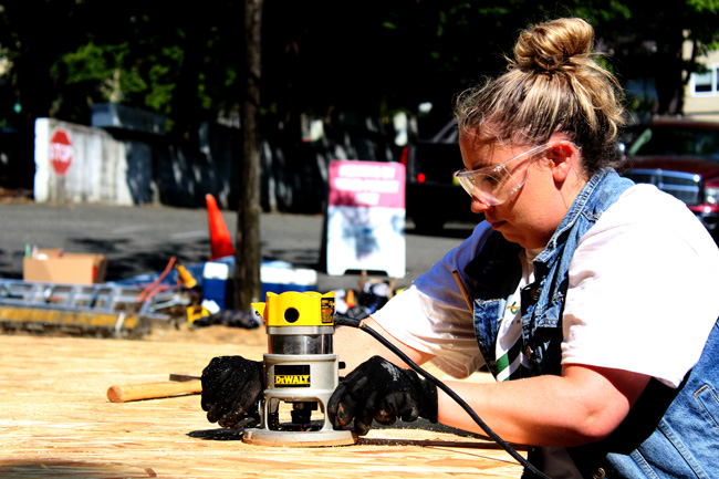 """Around 100 volunteers were out at the Seattle Vocational Institute on Friday to construct eight tiny homes for people experiencing homelessness around the city.   http://www.capitolhilltimes.com/Content/News/Schools-Youth/Article/LIHI-receives-big-help-with-tiny-houses/26/344/5125   """"There's so much preparation and coordination, and making sure everyone knows the logistics..."""" said Krishna Richardson-Daniels, program and training director for SVI's Pre-Apprentice Construction Training (PACT) program.  SVI is a division of Seattle Central College, and its PACT program prepares students – many minorities from distressed zip codes - for apprenticeship programs with companies that lead to high-paying construction jobs, Richardson-Daniels said. About 65 percent of students get into apprenticeship programs, she said.  PACT students try to construct two tiny houses per quarter, and SVI has been partnering with the Low Income Housing Institute for about six years now to create 150-square-foot tiny houses. Those are provided to villages set up for people experiencing homelessness through a partnership between LIHI and Nickelsville, and provide a better shelter option than tents.  """"It gets them out of the cold,"""" said Josh Castle, LIHI volunteer and advancement manager. """"It gets them out of harsh conditions. It gets them out of the rain.""""  The tiny houses at the homeless encampments have electricity, and the tiny villages have shared bathrooms and sinks. Castle said one of the most important features for people is the ability to safely store their belongings somewhere.  """"It's a really satisfying experience to hand somebody a key,"""" he said.  PACT student Brittiny Johnson said she's looking for an operators apprenticeship. Before joining the program, she said high school was her last educational experience, and that was 10 years ago. Johnson said she isn't a fan of classrooms, but she likes what she's doing now because there's a lot of hands-on learning.  """"This is like the perfe"""