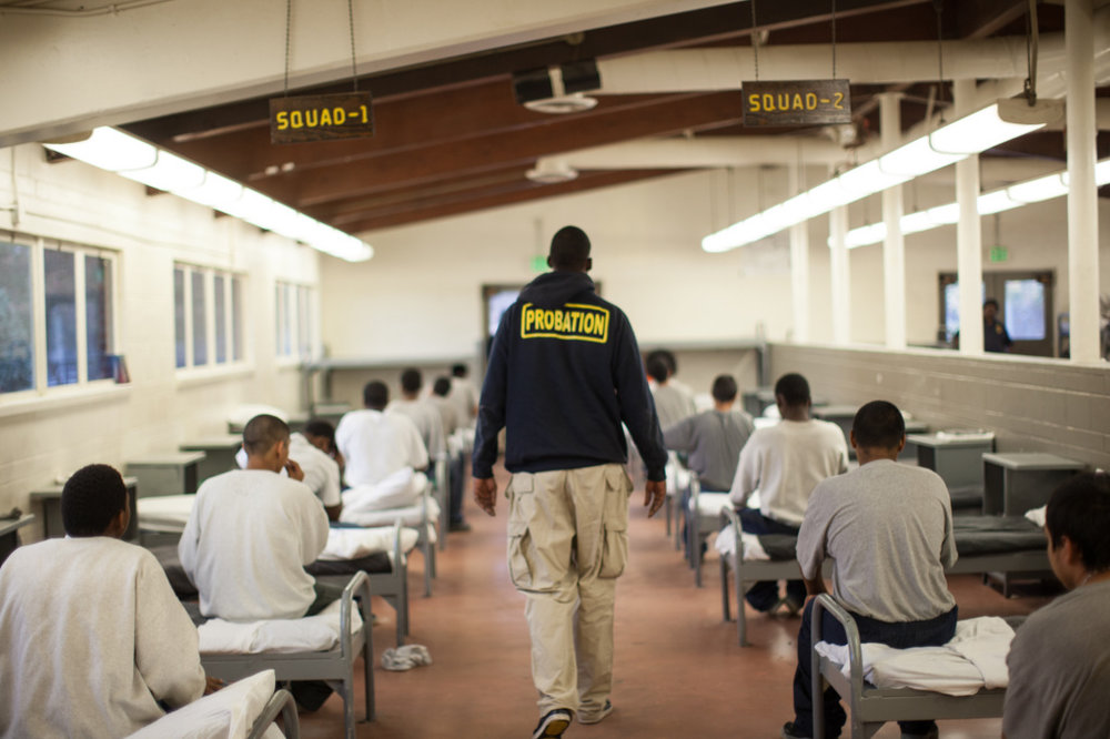 "A new study finds that the troubles of the hundreds of youth leaving the juvenile justice system in Los Angeles County each year may have started at home in early childhood.   https://www.scpr.org/news/2017/10/06/76359/a-pipeline-to-juvenile-detention-a-new-study-aims/   For most coming out of juvenile detention, the county's child protective system had received a warning about their mistreatment as kids, according to  the study  released Friday from the University of Southern California's Children's Data Network.    Four out of five exiting in 2015 had at least one referral to the Department of Children and Family Services's  child protection hotline  for suspected maltreatment, researchers found. For nearly half, those referrals occurred before age 5.    ""The reason we're so interested in this finding [is because it] means that we can offer those families support and help at the time of the initial call – as opposed to waiting until they've already committed a crime or are already involved in the juvenile justice system,""  said Jacquelyn McCroskey, co-director of the Children's Data Network at the USC Suzanne Dworak-Peck School of Social Work.  Researchers examined the records of 387 youth who exited from juvenile detention camps or other probation settings in 2015.  While 83 percent had referrals to child protective services, more than a third had a maltreatment report substantiated, and 20 percent had been removed from their home due to abuse or neglect.   ""It's very difficult for many youth to figure out a way to a positive future after multiple such experiences,"" said McCroskey.  The researchers hope that illuminating this connection will help the county identify ways to provide supports for families earlier to both prevent maltreatment and delinquency.  Previous studies  from the Children's Data Network have examined linked between youth in juvenile detention who had previously been in foster care or had open cases, but had not looked at referrals through the DCFS hotline.   ""We are increasingly realizing that a simple call to the child protection hotline is often a call for help,"" said McCroskey. ""But what the child protection system usually has to offer is protection for the child and not help for the whole family.""   The report suggests the need for more collaboration between child welfare and probation agencies, more community-based services to help families after referrals are made and the adoption of a county-wide system to align public and private resources.   ""When we think about delinquency usually we think about it being that single youth who got into trouble,"" said McCroskey.  ""If – as many people have suspected for a long time – these are patterns that develop over time and we can support their families in the first place, I think the youth and everybody else is gonna be much better off.""  County officials have in recent years expressed renewed commitments to preventing abuse and maltreatment. In 2015, the county established the  Office of Child Protection  to encourage collaboration between the siloed agencies in the county. Across the state and country, the early childhood field is rallying around the concept of trauma-informed care, which takes into account the causes of behavior issues.  ""I'm glad that we have a growing awareness that perhaps the behaviors that we call crimes and label as delinquency are rooted in many familial and environmental factors that stem from much earlier in their childhood, so we can start to really address some of the root causes of the behaviors,"" said Patricia Soung, director of youth justice policy at the Children's Defense Fund."