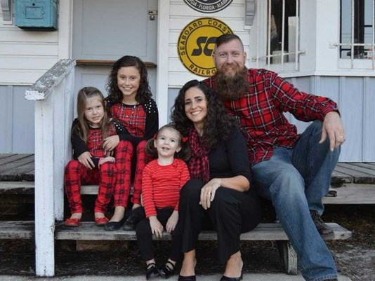 "A couple from Green Cove Springs is taking a leap of faith, growing their family from three daughters to seven overnight in hopes of making a difference.   http://www.wcnc.com/news/community/house-of-hope-family-is-selling-home-to-live-with-homeless-students/493572666   Pastor Billy Mills from  Reverb Church , along with his wife Isabel Mills and their children, have decided to move to St. Augustine to live with four homeless students they have never met.  ""There are going to hopefully be a lot of memories here around the dining room table with seven daughters,"" Billy Mills said.  They have put their house in Green Cove Springs on the market and hope they'll be settled in their new home in St. Augustine at the beginning of the year where they will be mentoring the homeless students they have yet.   ""Some people say 'how can you do that?' and the question that I ask is 'how can you not?'"" Billy Mills said.   Currently, there are more than 400 homeless students in the St. Johns County School District. More than 100 of them  - including the four planning to live with the Mills -  are ""unaccompanied youth,"" according to the District. In other words, they don't have a parent in the picture, or anyone to take care of them or lead them down the right path.  ""Just thinking of the people, thinking of the kids out there, they don't know where they're going to spend the night, they don't know where their meal is ... "" Isabel Mills said. ""We would be the closest thing to their parents.""   The four girls who will live with the Mills will be a year or two away from graduating high school.  They will be chosen by the non-profit organization, Somebody Cares of St. Augustine, to move into the Mills' new home, which is owned by the  Homeless Commission .  They will live in a neighborhood full of second chances.  Many of the families who live nearby used to be homeless.  ""This is exciting because these homeless girls that are living in pillar to post, sometimes in their car, sometimes go from home to home just [with] a bucket full of things because they can't take everything with them,"" said Kim McNickle, the executive director of Somebody Cares.   McNickle said the home will represent a stable environment where the girls can feel safe, secure and loved; ""something they haven't probably felt in awhile,"" she said.    McNickle also said the girls will live with the Mills rent free.   ""We don't want anything, any burden on them whatsoever,"" she said. ""We don't want them to worry about, you know, how to get to school, how they're going to pay for books, how they're going to pay for rent or any of their food. We want everything to be totally taken care of 100 percent for them.""  McNickle and the Mills said the goal is to end the cycle of homelessness and give the students hope.   ""How do we say 'no,' ... how do we live life normally knowing there's kids that don't have a place to live?""  Bill Mills said. ""How do we pursue the American Dream while there are so many people in our community that don't have some of the basic necessities? ... We don't see it as something extraordinary. We see it as this is how we play out our faith; this is how we show the world this is who God is."""