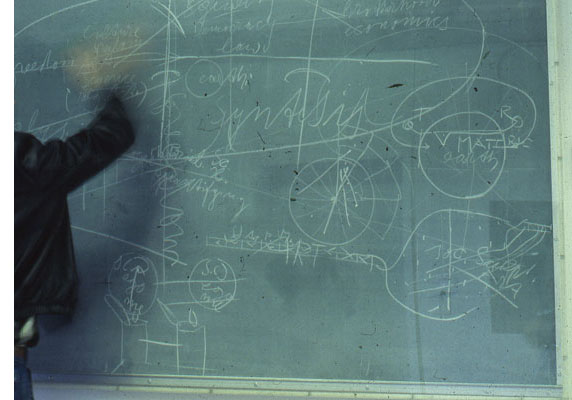 Eyland attempts to erase a blackboard by Joseph Beuys at the Nova Scotia College of Art and Design in 1980. (Fortunately, the blackboard was under glass, because a few years later this 1976 Beuys work was sold the Art Gallery of Ontario in order to support a NSCAD scholarship.)