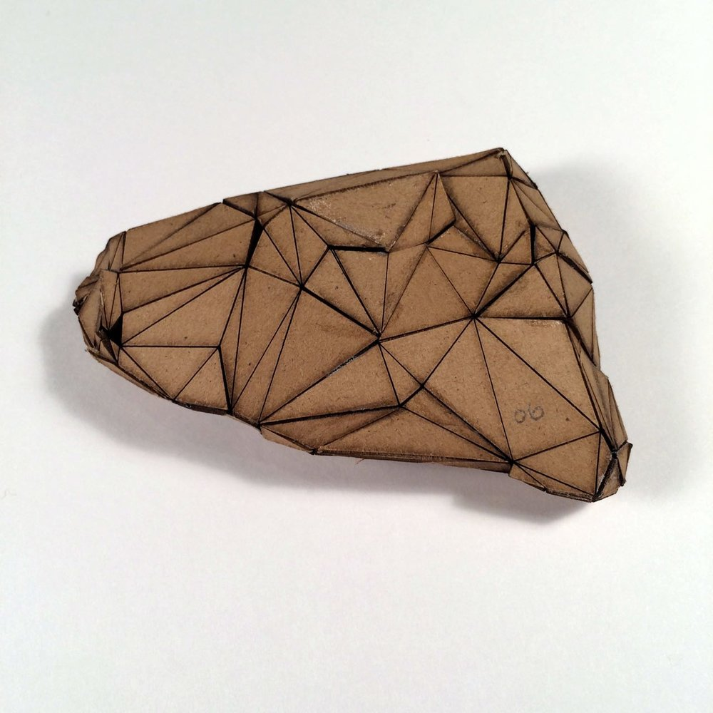 (Front view) 006 - Boxes For Rocks, laser cut cardboard, found rocks, glue, 12cm x 8.5cm x 3cm (flatish), 2012, 250 CAD