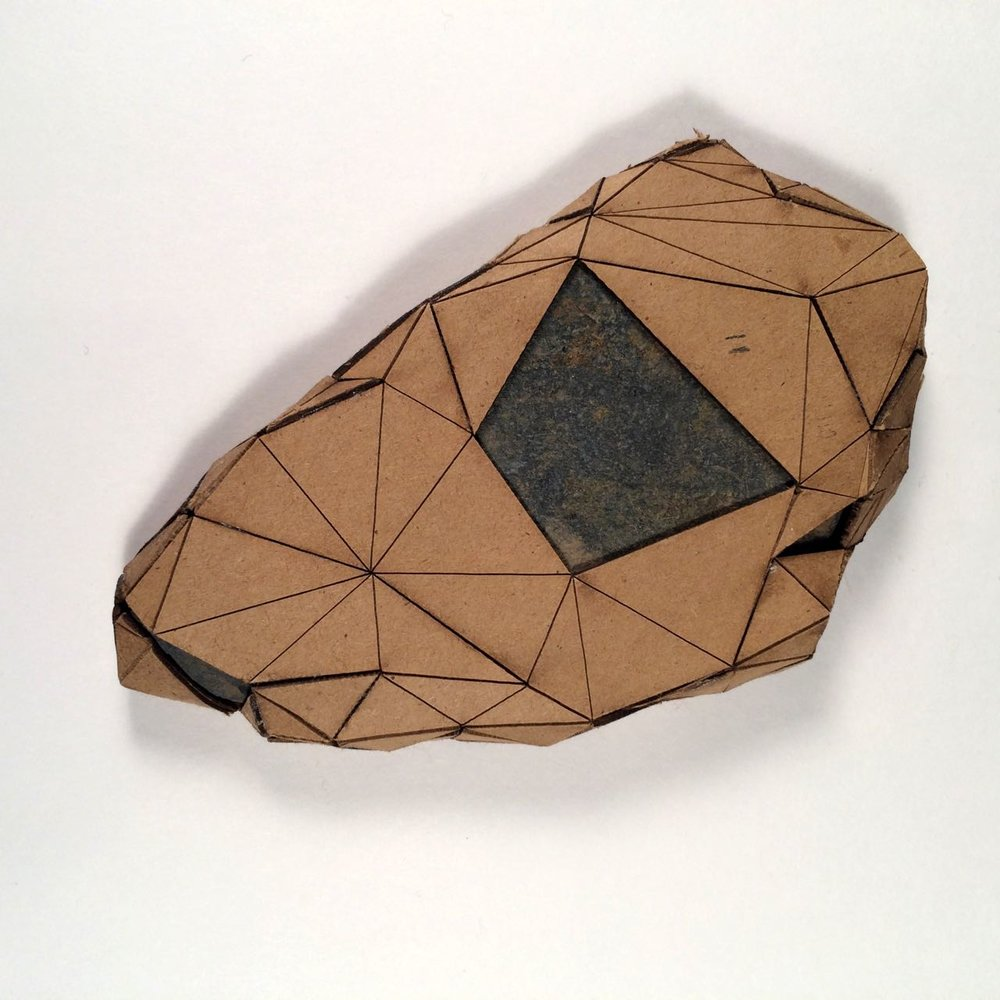 (Front view) 011 - Boxes For Rocks, 2012, laser cut cardboard, found rocks, glue, 13.5cm x 8.5cm x 1.5cm (flat), 250 CAD