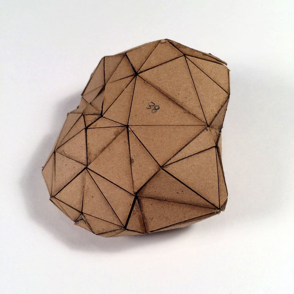 (Front view) 038 - Boxes For Rocks, 2012, laser cut cardboard, found rocks, glue, 9.5cm x 9cm x 4.5cm (roundish), 250 CAD