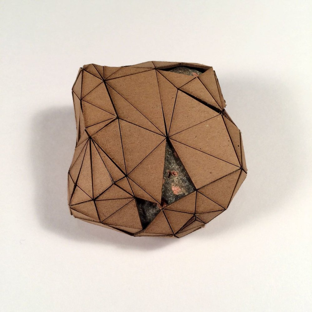 (Back view) 038 - Boxes For Rocks, 2012, laser cut cardboard, found rocks, glue, 9.5cm x 9cm x 4.5cm (roundish), 250 CAD