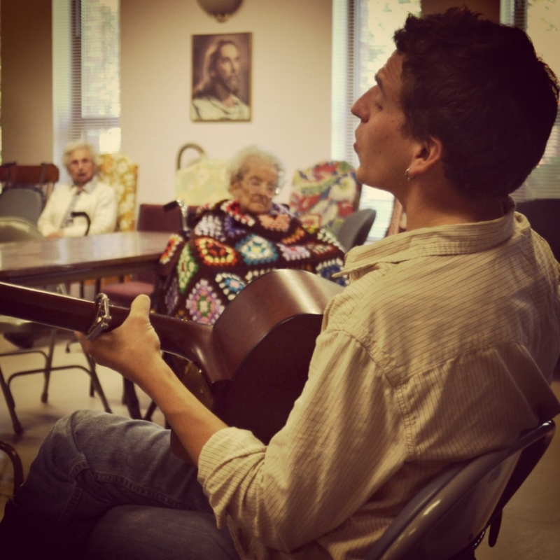 George playing for senior citizens. Photo courtesy of Eric George.