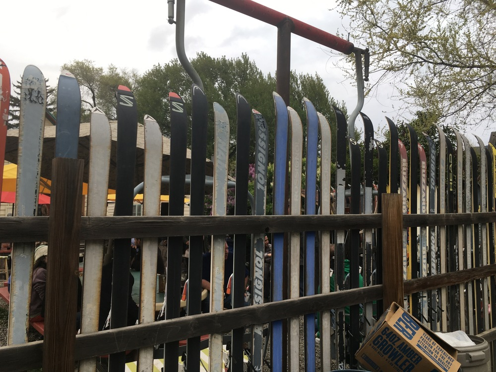 Of course, the fence was made of skis and two seats were fashioned from ski-lifts