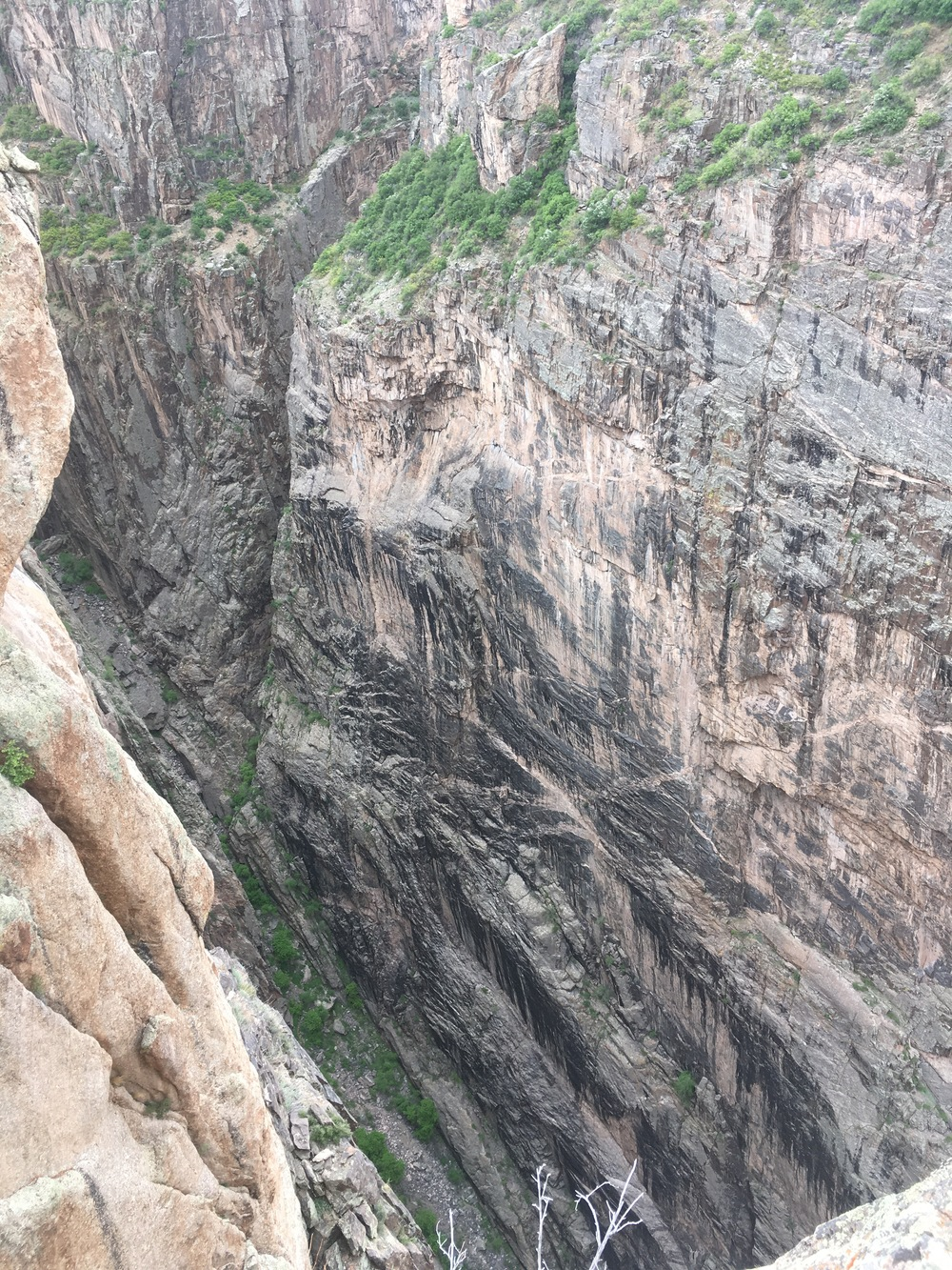 Discoloration and true black-canyon walls.