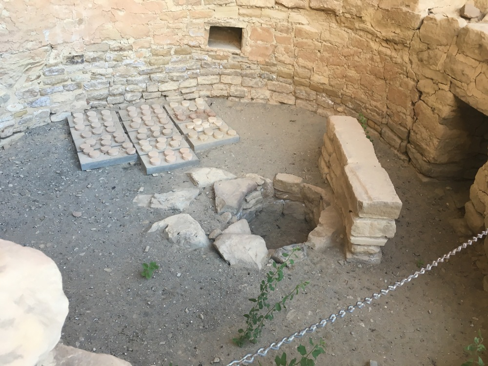 A kiva, one of the circular, ceremonial rooms. In the center is a firepit.