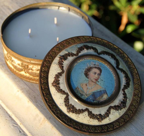 This antique tin features a painting of Queen Elizabeth surrounded by a raised ornamental pattern in white and gold.  Remove the lid and you find a hand-poured, lightly-scented 100% soy candle nested inside.   More than a candle…a cherished keepsake.