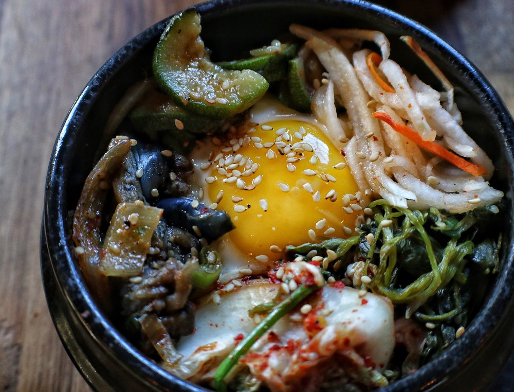 Sizzling Stone Pot Bibimbap  org white rice & grass fed bulgogi