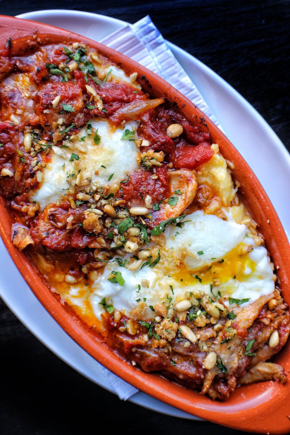 Baked Eggs  Polenta, Braised Chicken, Butter Roasted Tomato