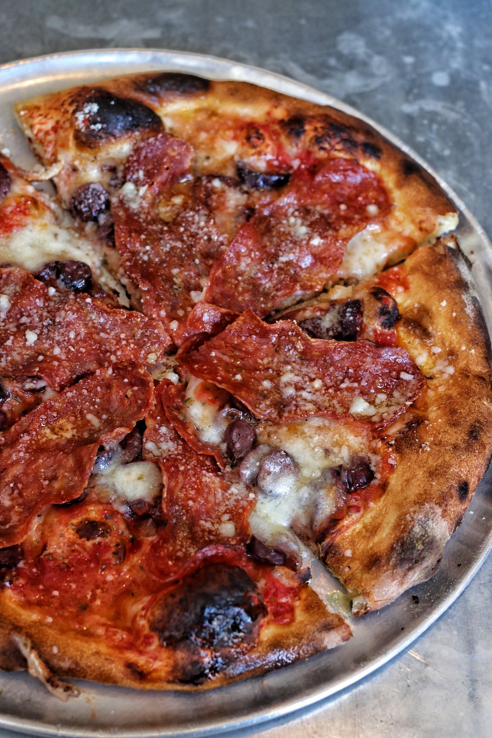 pizza- tomato, spicy salami, olives, bualo mozzarella