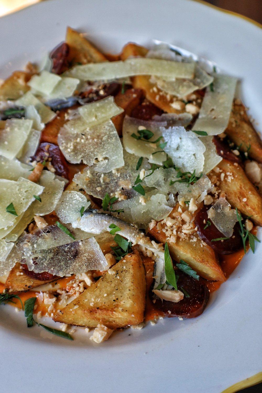 POTATO SKIN BRAVAS  Chorizo, Manchego, Boquerones, Spicy Aioli, Marcona Almonds