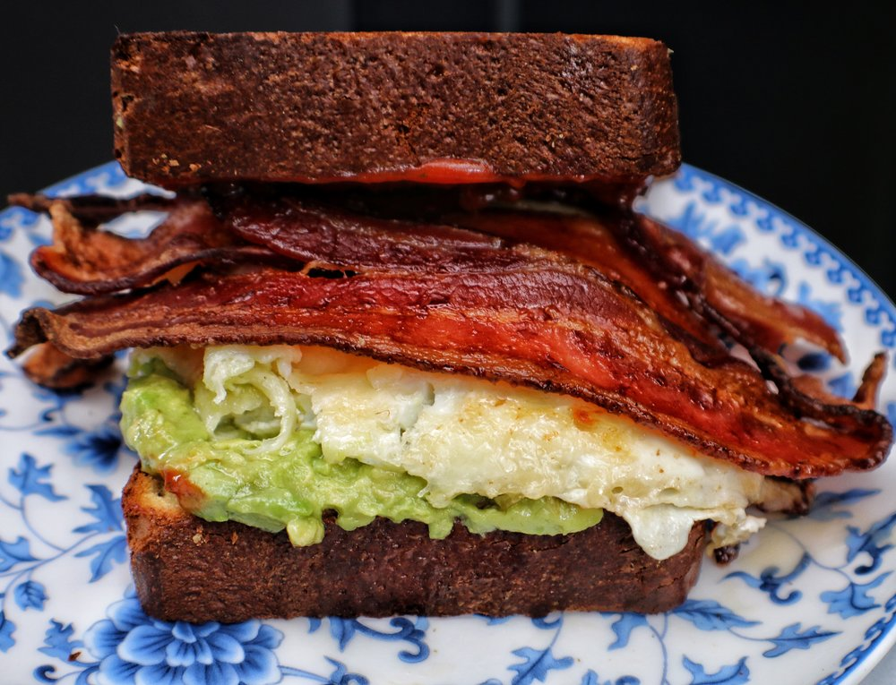 breakfast sandwich / avocado, bacon, egg, srirancha ketchup