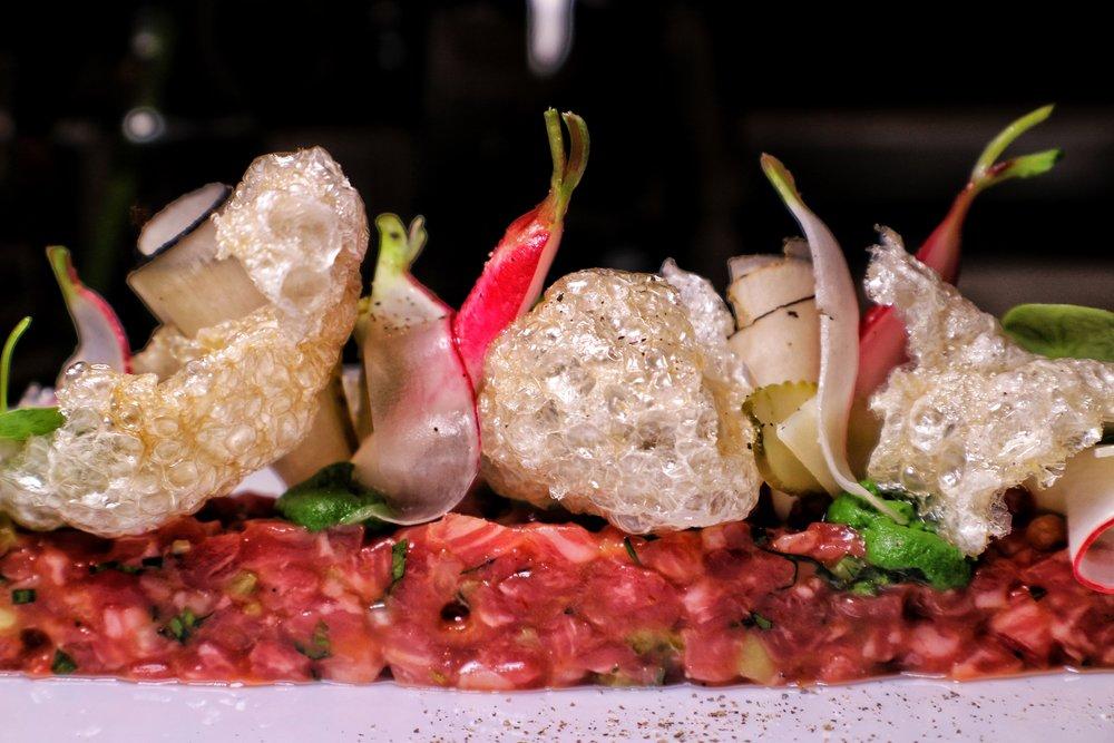 Aged creekstone beef tartare, wasabi cream, pickled radish, crispy beef tendons