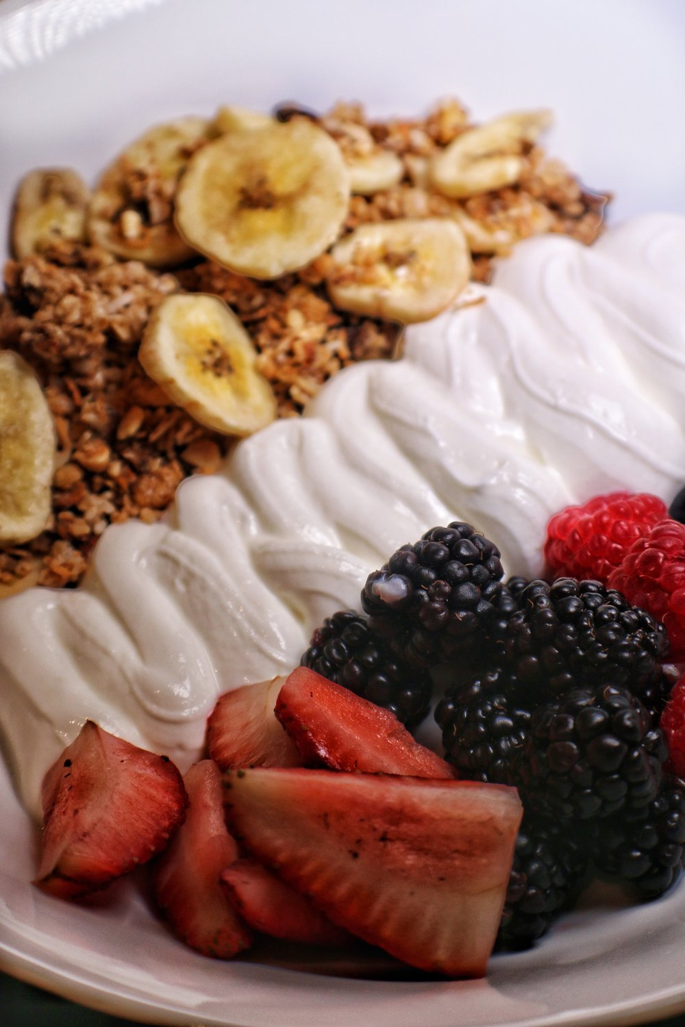 Homemade granola, winter fruits, Greek style yogurt