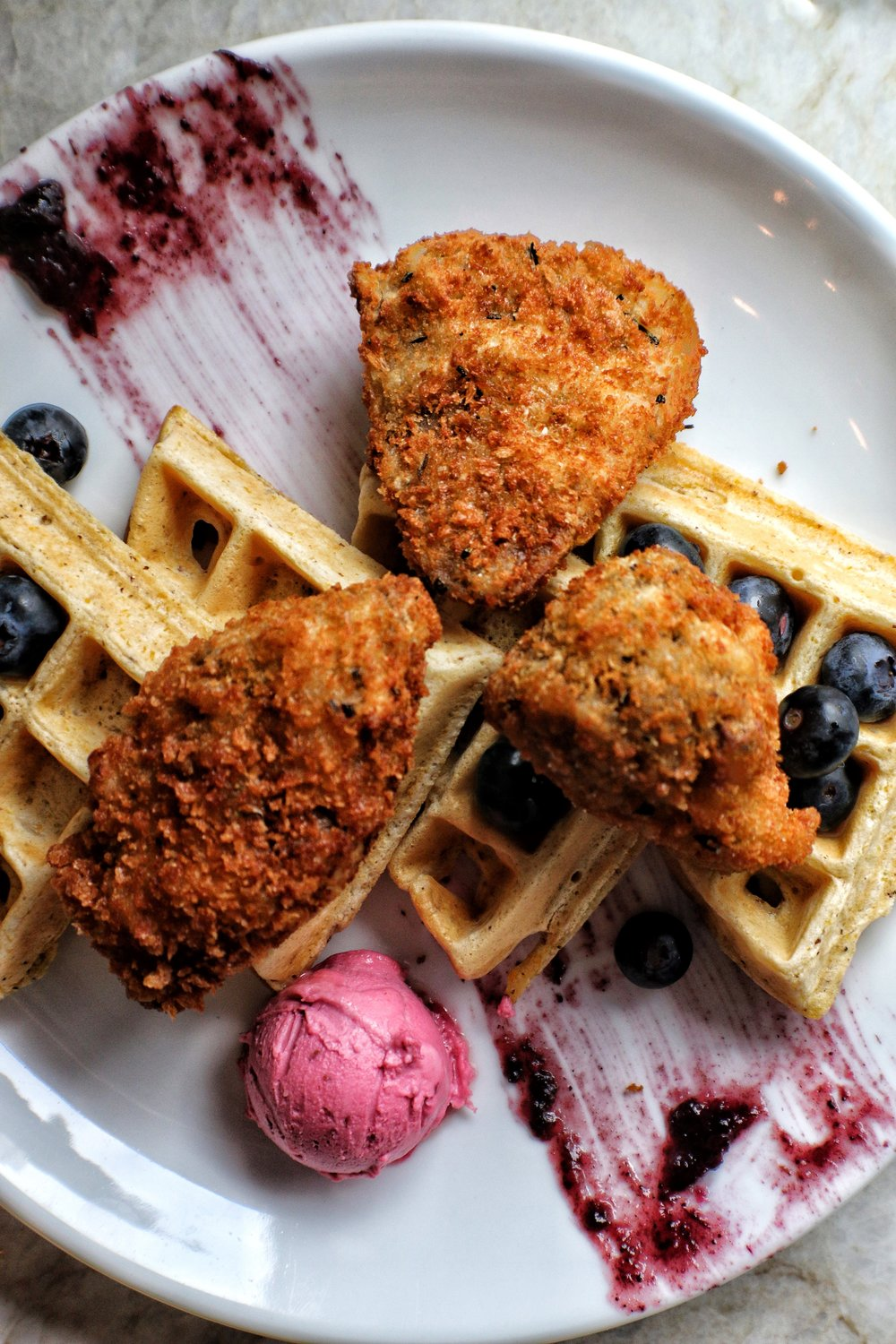 Seitan & Waffles  rosemary breaded seitan, malted waffle, fresh berries, raspberry butter, maple syrup 15