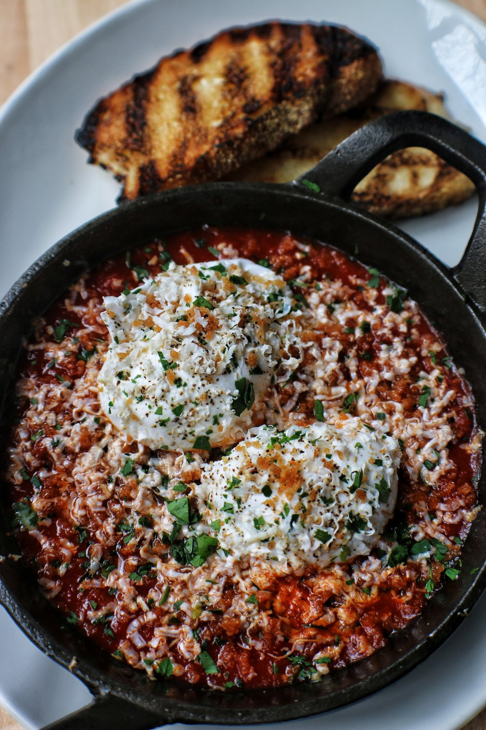 sunday gravy eggs in purgatory with smoked ricotta silatta & grilled bread