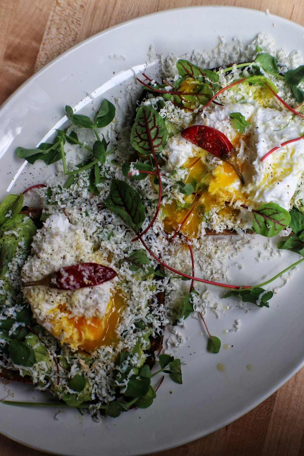avocado toast with slow cooked eggs & calabrian chiles