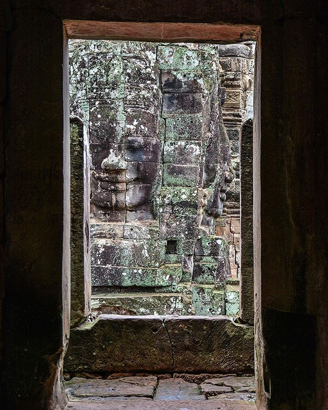 Frame within a frame. Finding a quiet moment at the iconic Bayon temple in Angkor.