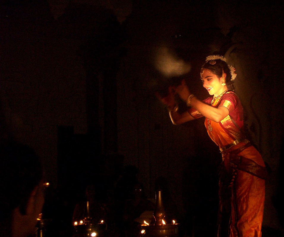 Candlelit Arangetram | Dancing during full power outage at Sri Siva Vishnu Temple, MD, 2003 | Photo: Vijay Venkatesan