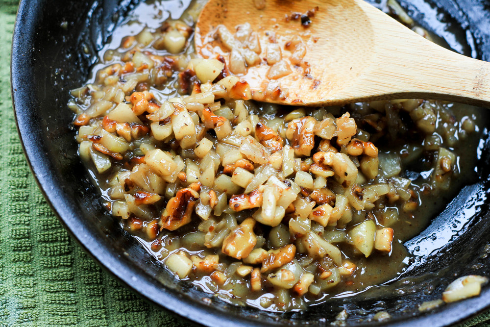 Diced pears and walnuts softened in butter
