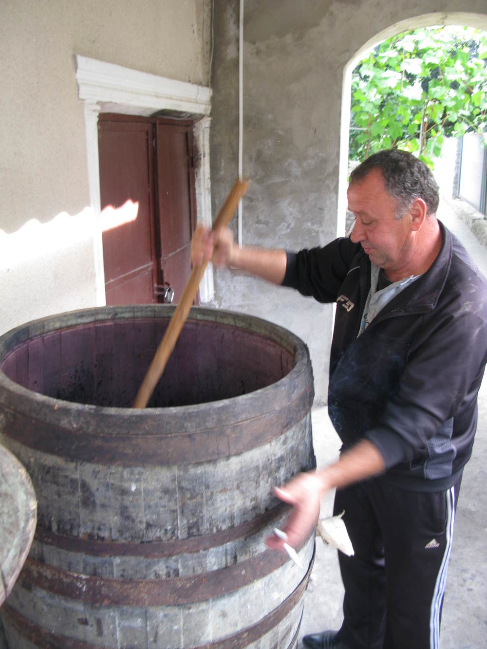 Punching Down the Homemade Red Wine