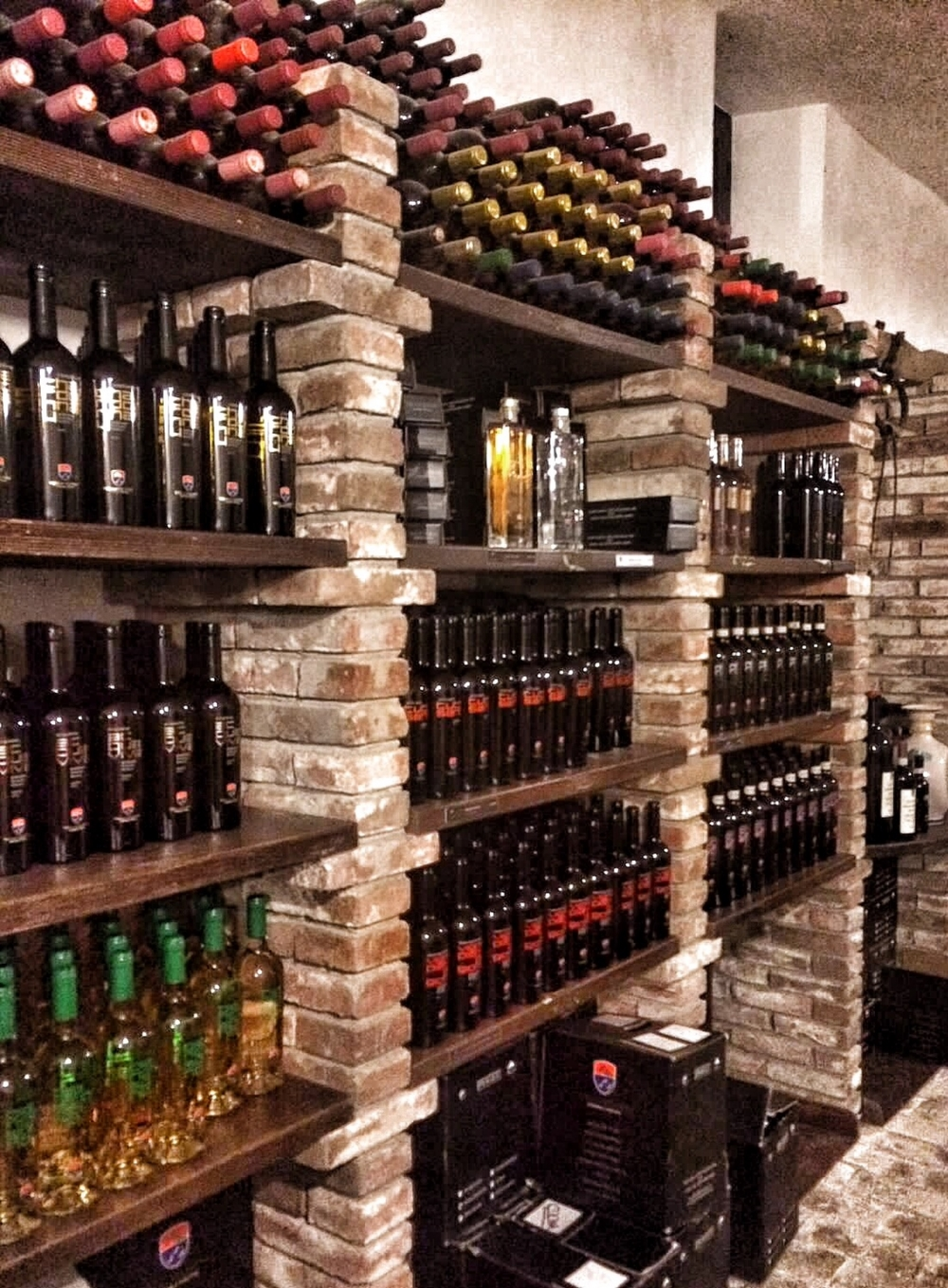 The various types of vine: Sangiovese, Malvasia nera, Alicante, Trebbiano, Chardonnay, Verdello - produced by the Vineyard can be tasted in the wine bar, which is located inside the old wine cellar of the country hotel (Villa Acquaviva, Montemerano, Maremma, Tuscany)